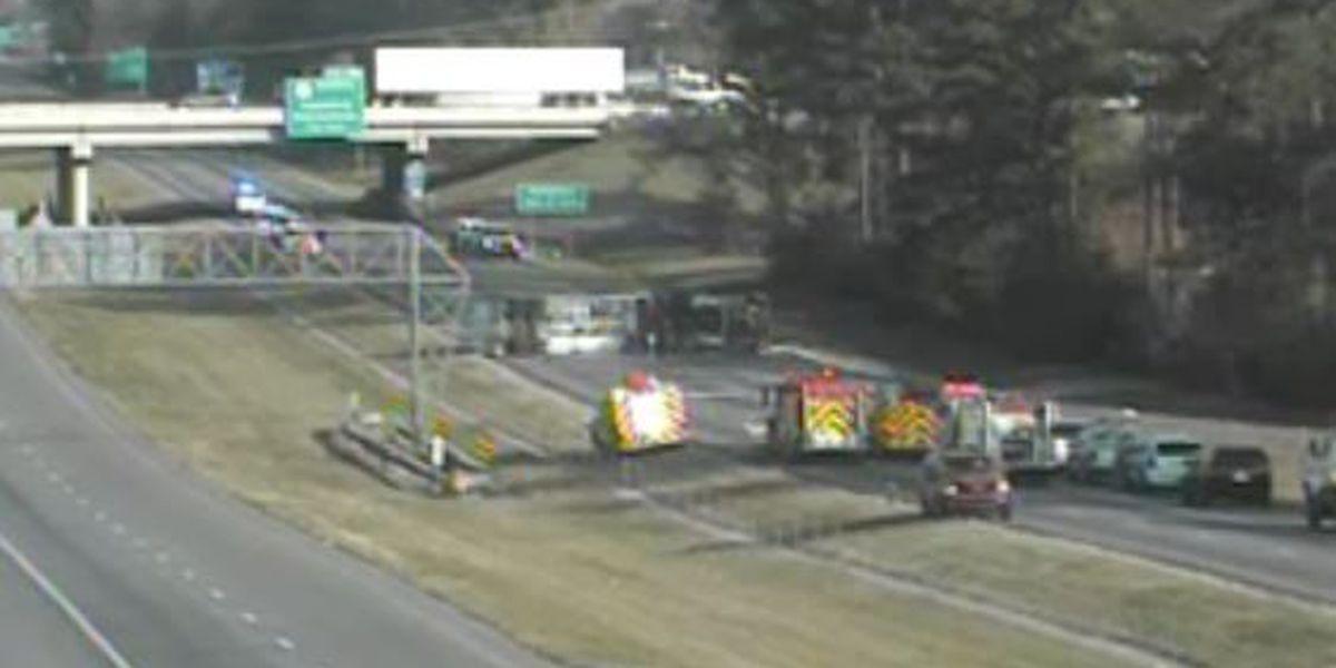 Overturned 18-wheeler shuts down I-12 near Hammond