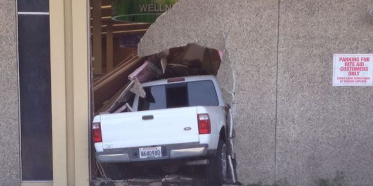 Massive hole left after driver crashes through Uptown Rite-Aid
