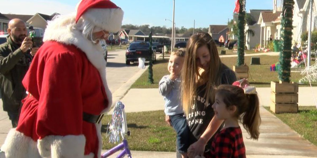 Officers surprise kids on Christmas Eve with toys, gifts and Santa