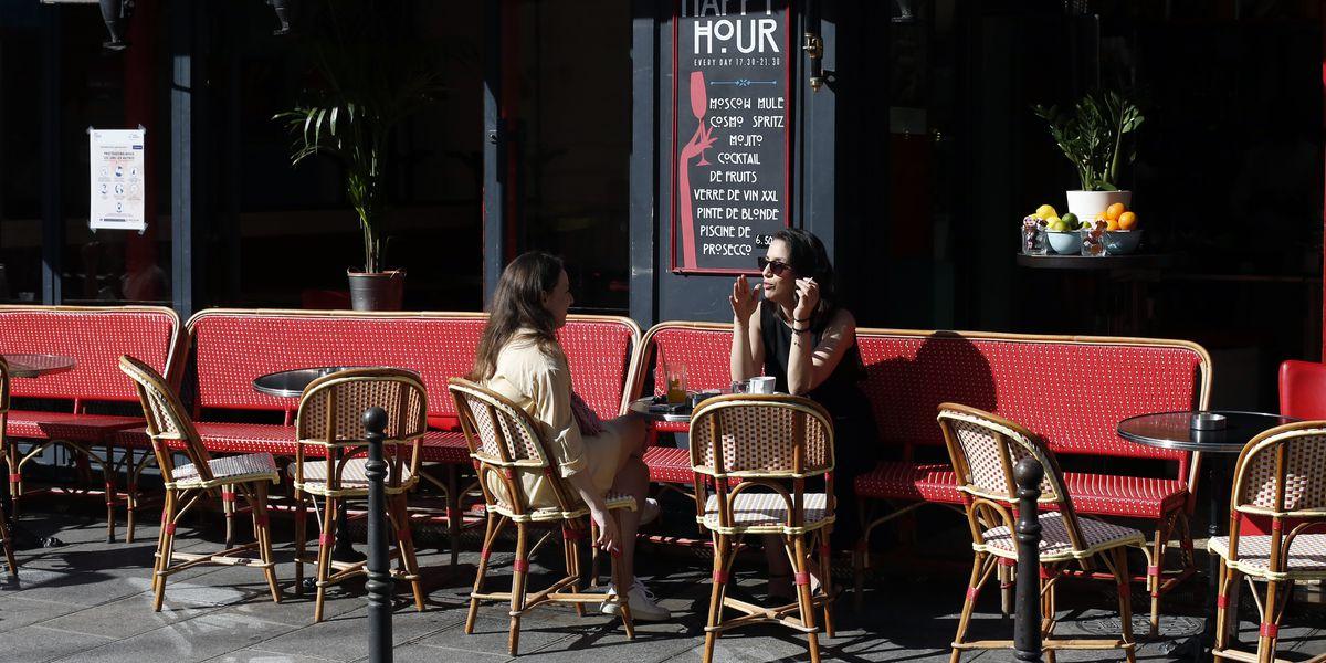 Parisians return to cafes; Latin America sees virus surge