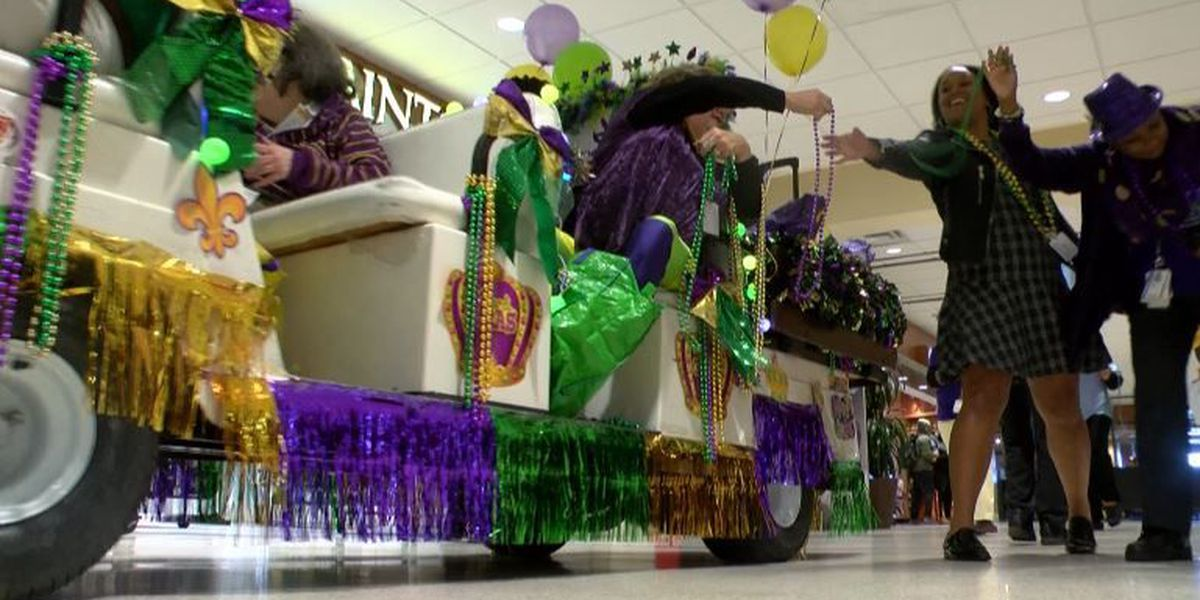 Airport staff puts on mini parade for travelers