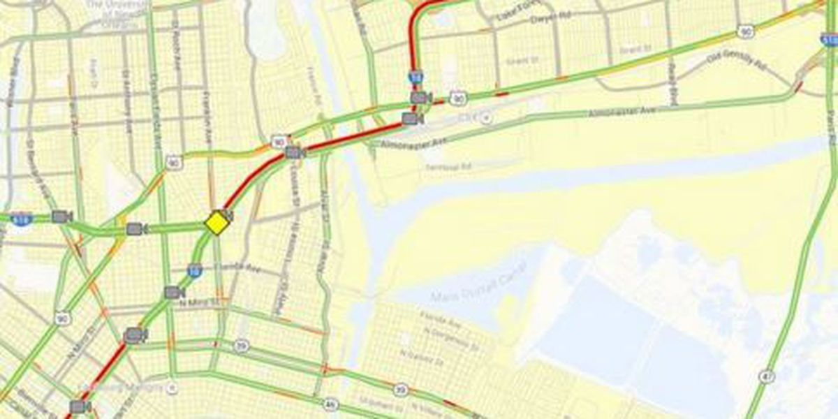 Traffic backups slow the commute in from New Orleans East