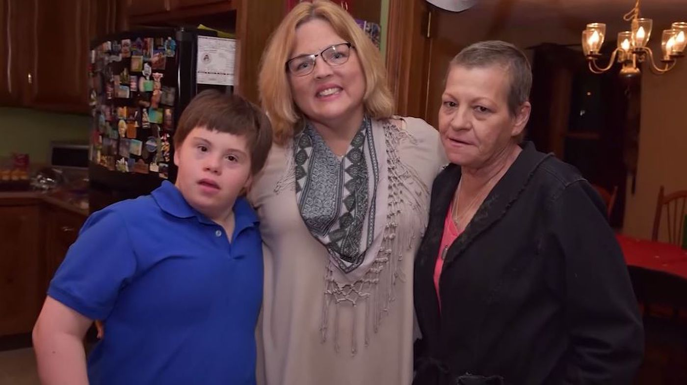 Knowing the single mother was suffering from terminal breast cancer, Kerry Bremer, center, offered to take care of Jean Manning's son Jake, as needed.
