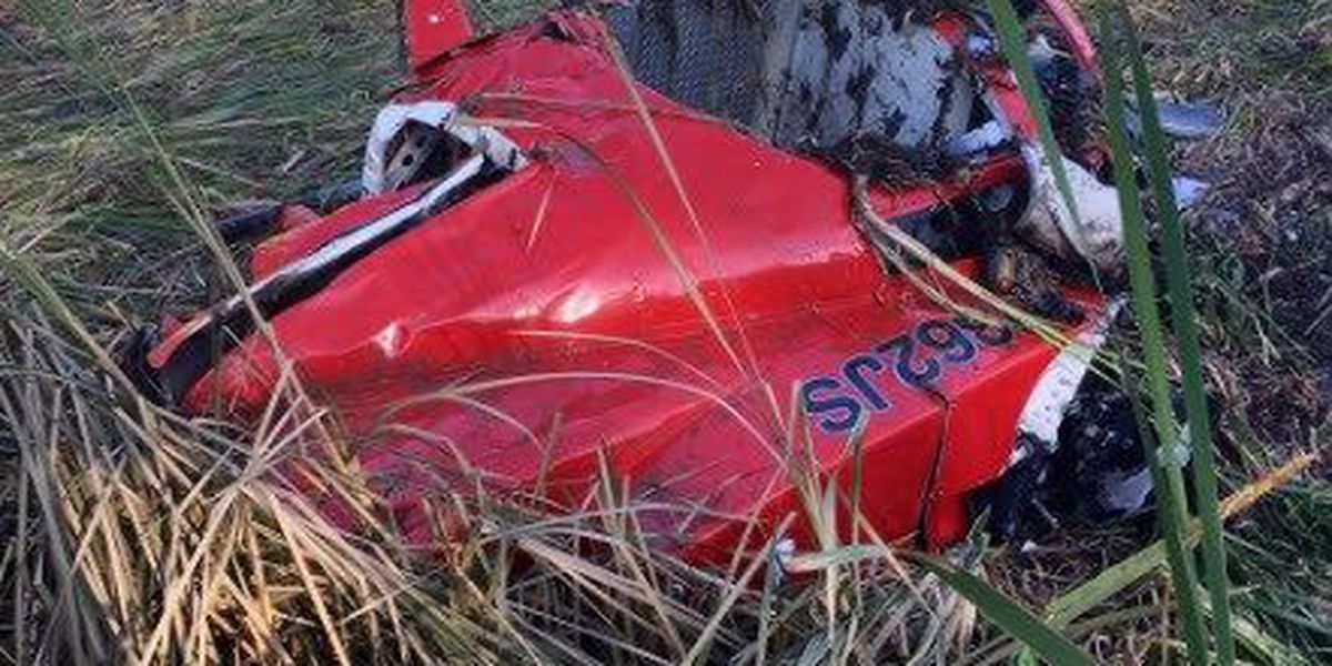 Helicopter crash kills one, injures two; neighbors help rescue survivors