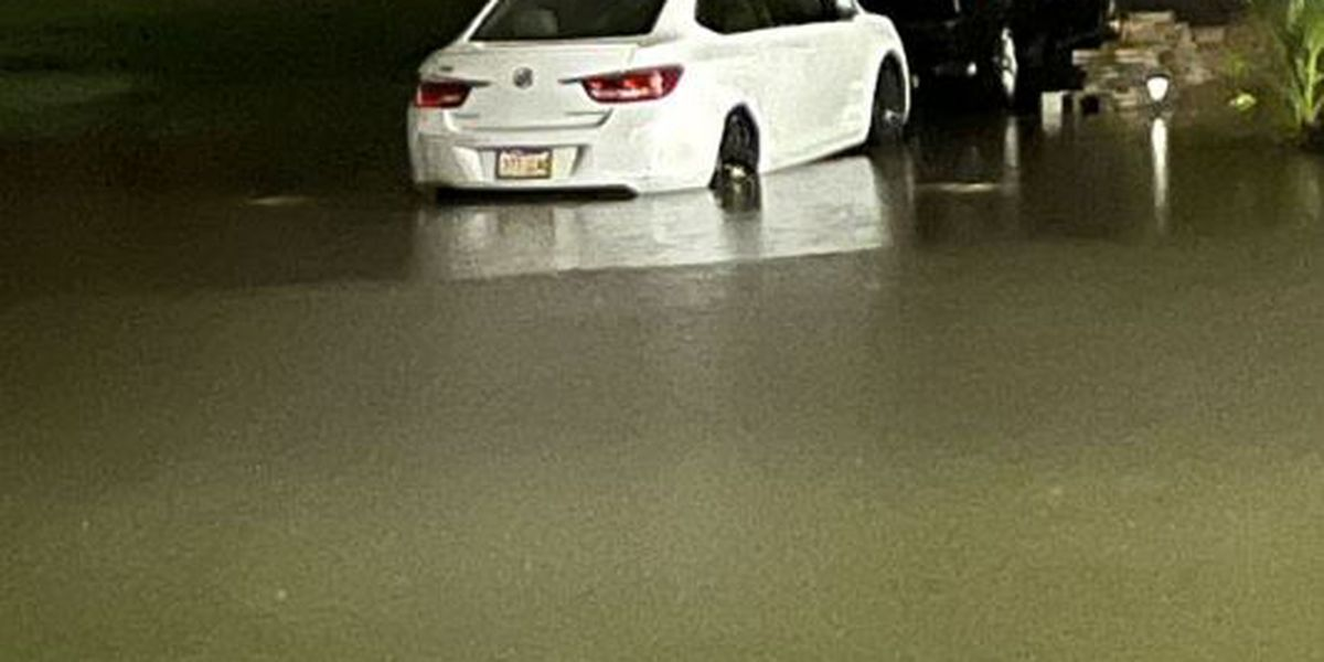 Flash flood warning in effect; several streets impassable