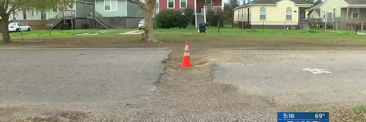 FOX 8 Defenders: Gentilly residents call pothole a safety hazard, driving on neutral ground to get around