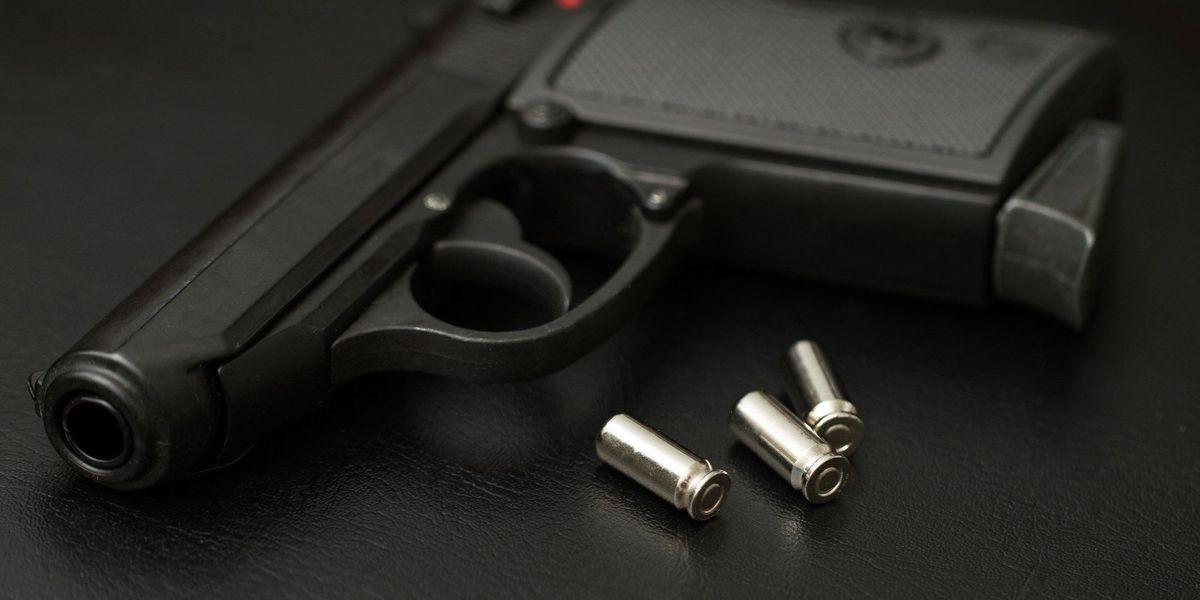 Postal truck robbed at gun point