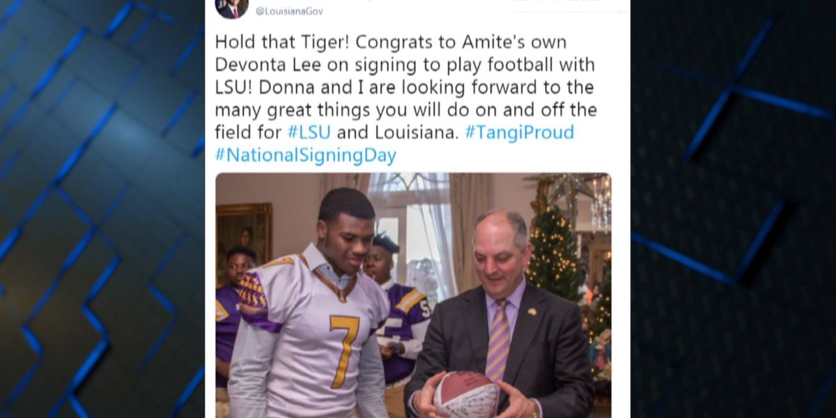 Louisiana Governor John Bel Edwards congratulates LSU signee