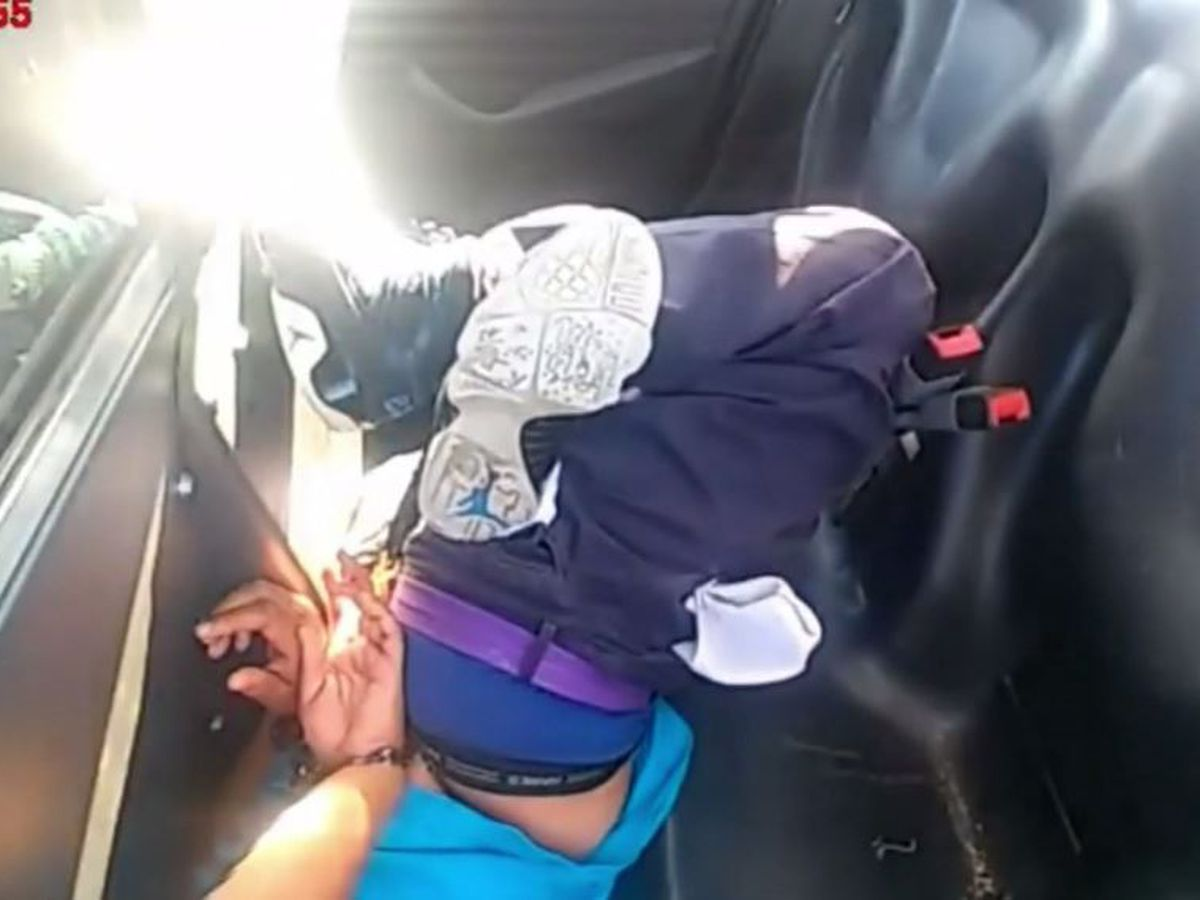 GRAPHIC: Hogtied Black woman begged for help in police cruiser, video shows