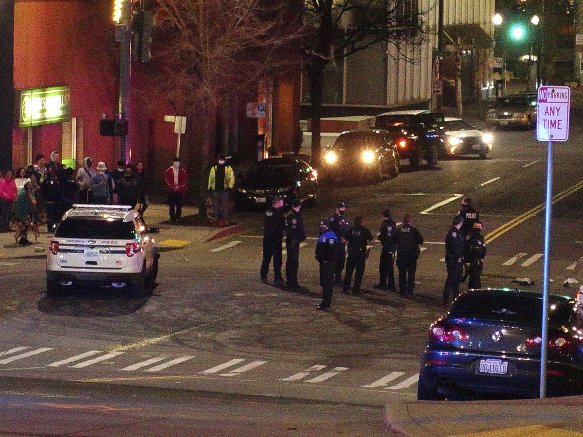 Person injured after police car drives through crowd at race