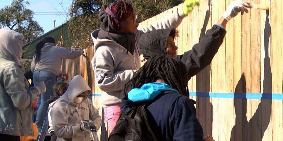 Volunteers renovate schoolyard to launch Tricentennial community service challenge