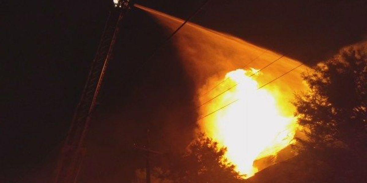 Fire fighters battle three-alarm fire Uptown