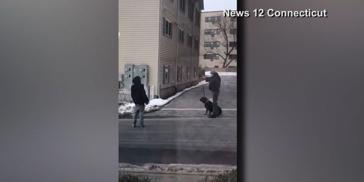 Woman records armed confrontation outside window, shouts at man to put down gun