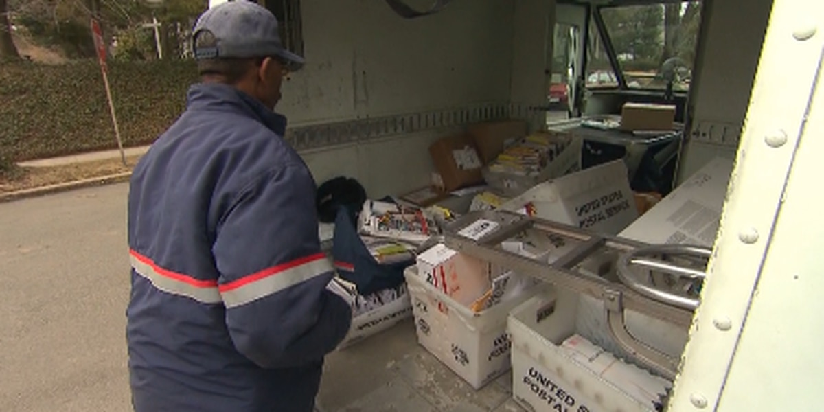 Locals react to postmaster's decision to halt postal service changes that some say would hurt voting-by-mail