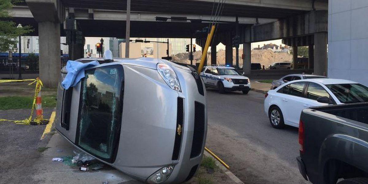 Passengers escape through sunroof after Mid City crash