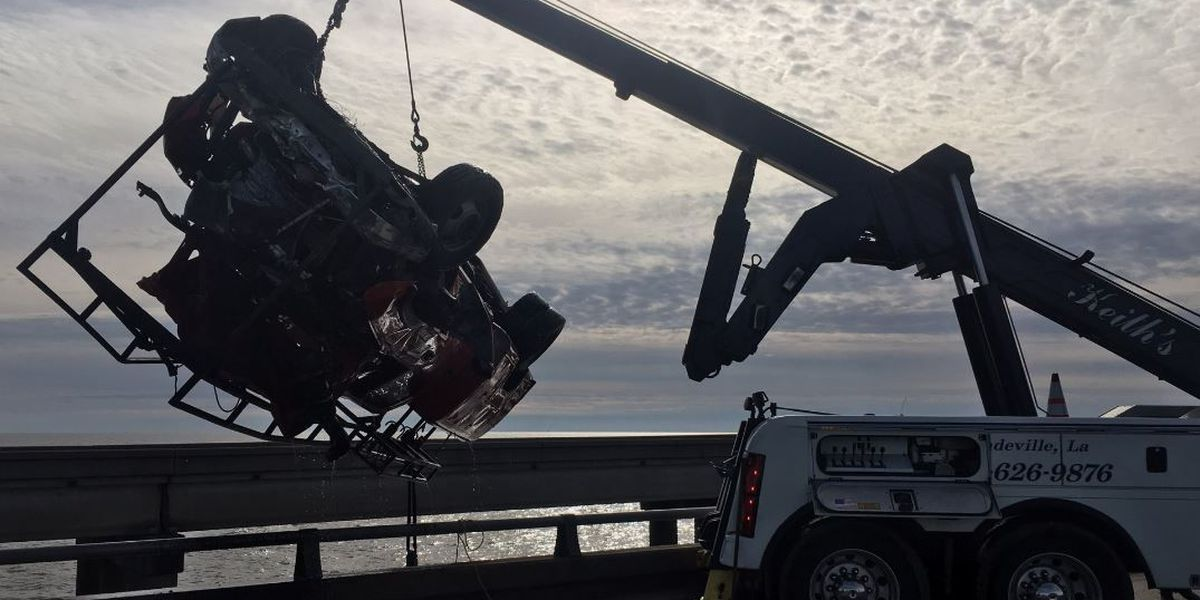 Truck recovered from lake, search for body continues