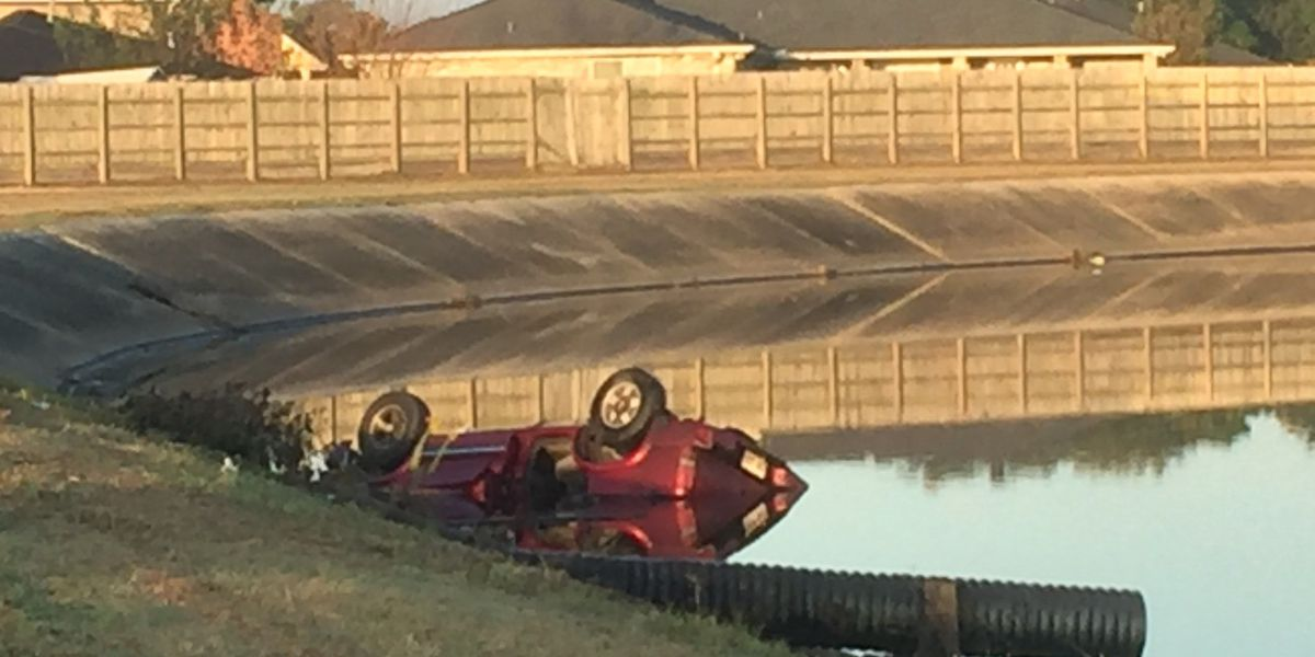 Car flips into canal during commute in eastern New Orleans