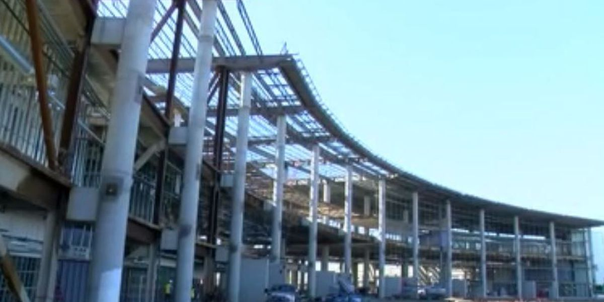Construction crews celebrate new airport terminal construction progress