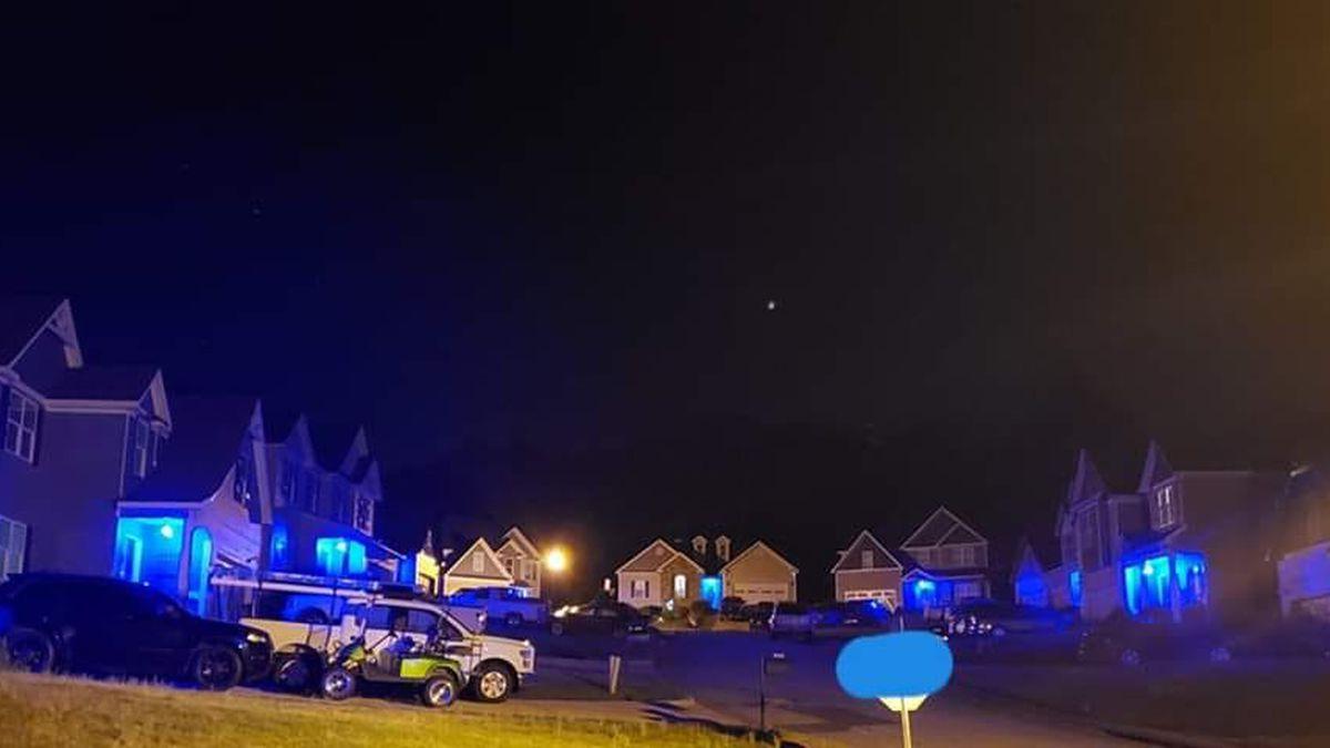 Fallen Ala. officer's neighborhood turns blue in his memory