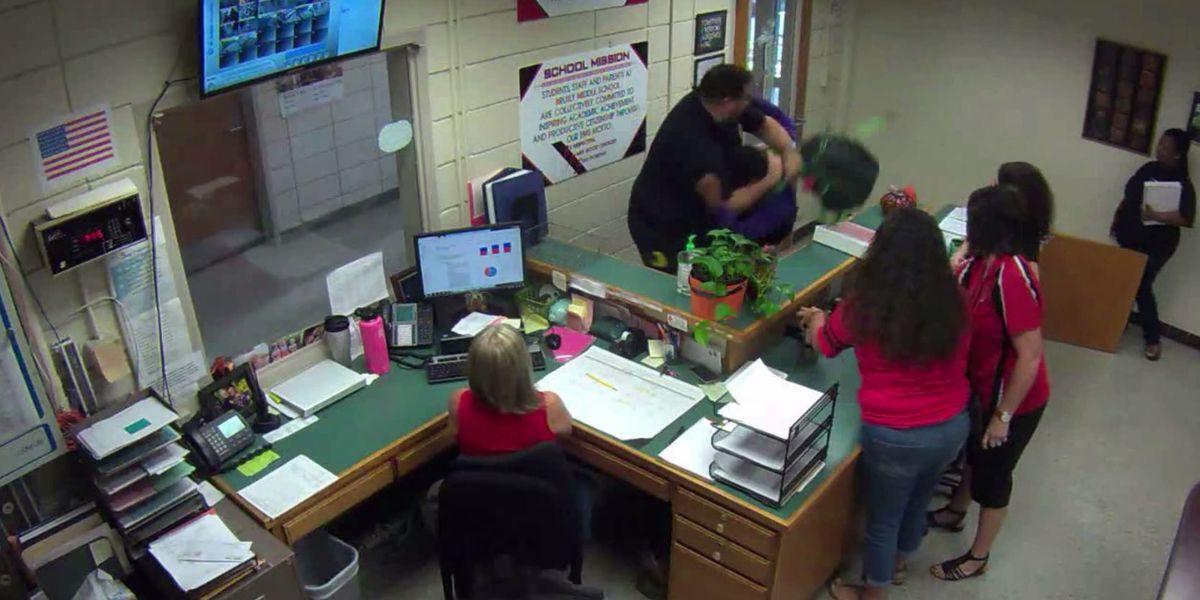Leaked video shows violent struggle as officer says student grabbed for gun