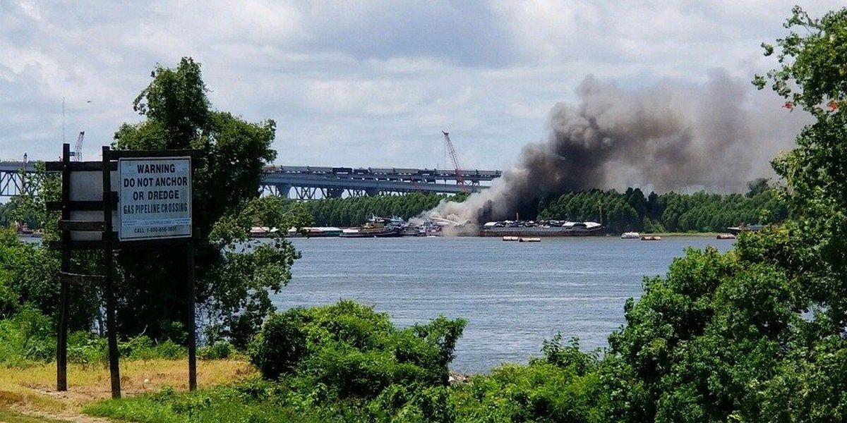 Firefighters working to extinguish barge fire near Huey P. Long bridge