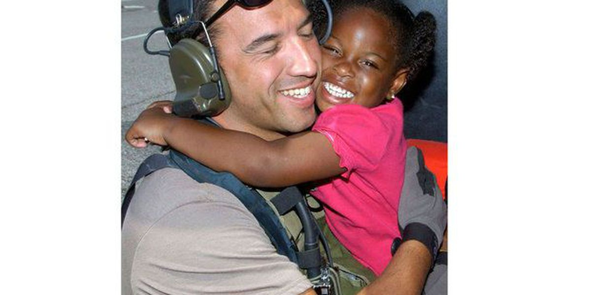 Former serviceman hopes to find girl he saved in iconic Katrina picture