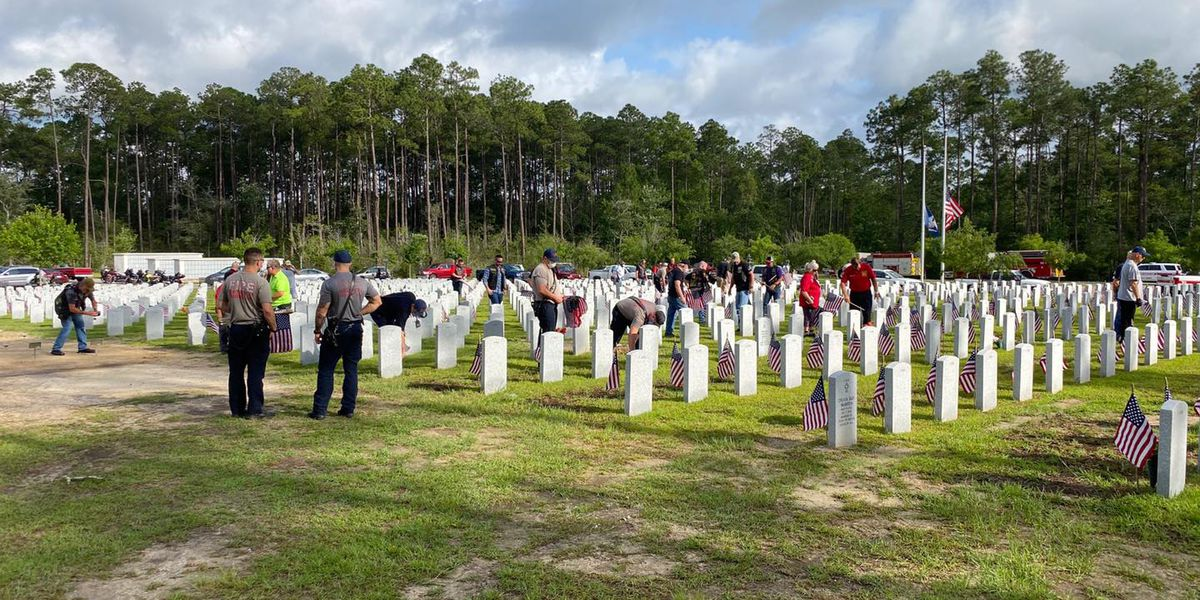 IMAGES: Flags placed at gravesites of fallen heroes at Louisiana Veterans Cemetery
