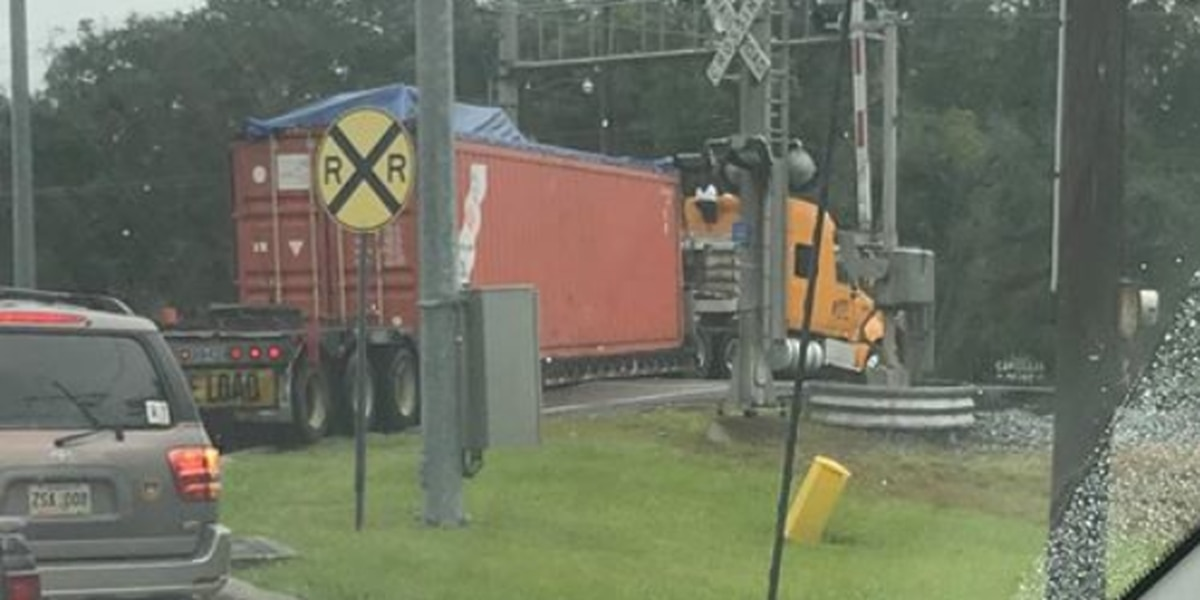 PICTURES: Truck gets stuck on train tracks in Slidell