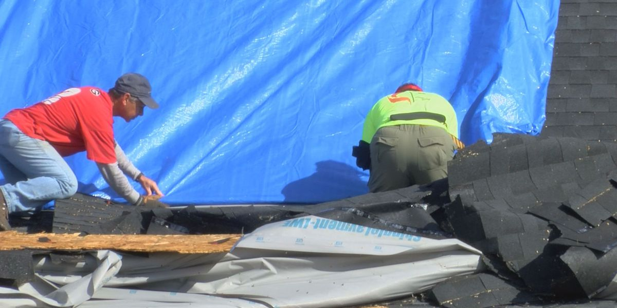 City leaders hand out tarps today for residents with damaged roofs