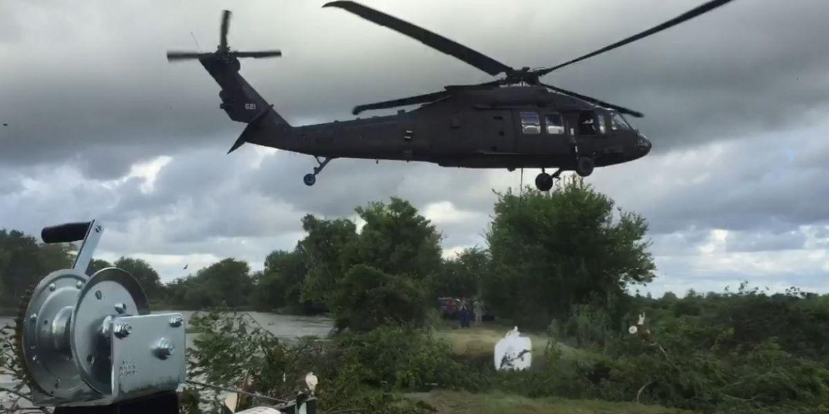 Choppers drop 1/2 ton sandbags to fix broken levee