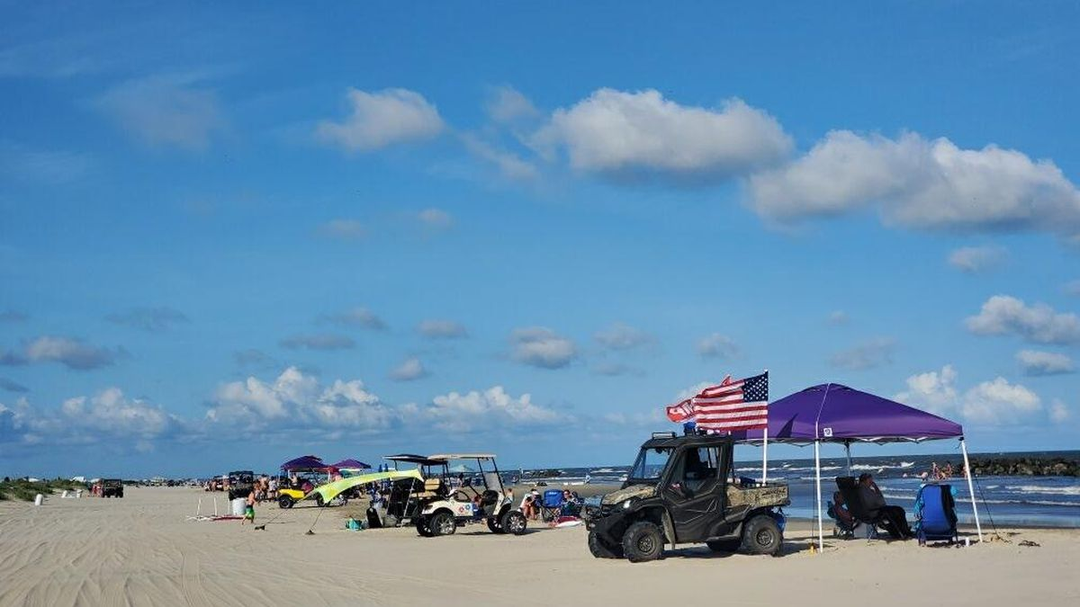 Families pack the beach in Grand Isle during Memorial Day Weekend
