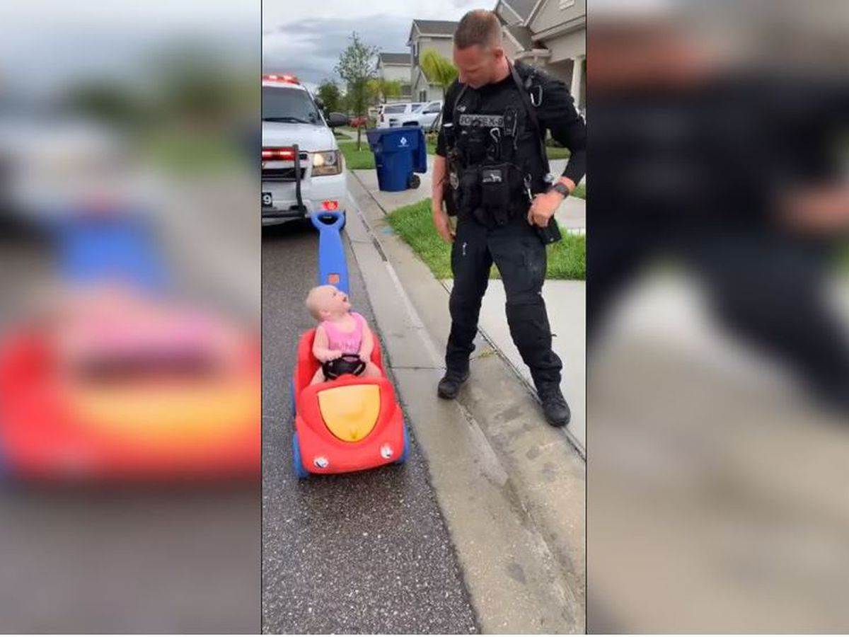 "VIDEO: Police officer dad ""pulls over"" adorable 10-month-old daughter"