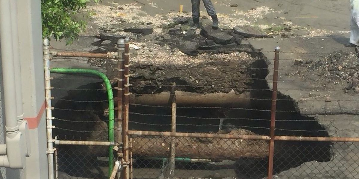 Broken pipe causes 10-foot sinkhole near river