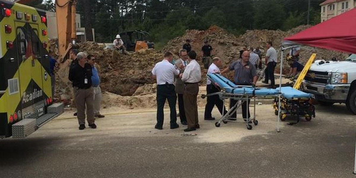 One dead, one trapped in Covington trench collapse