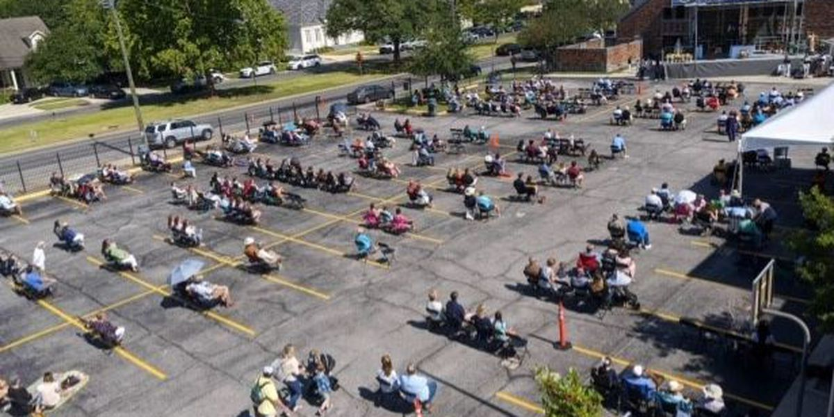 Hundreds attend Sunday service in parking lot of St. Catherine of Siena