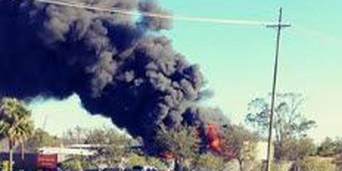 Fire fighters battle three-alarm fire in Harvey