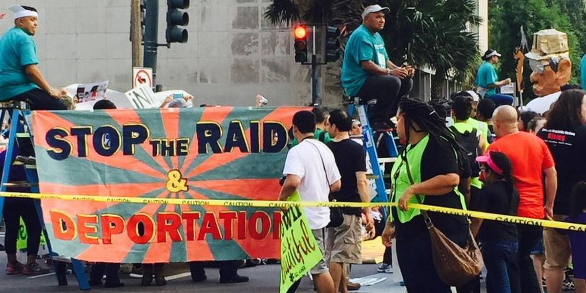 Undocumented immigrants blockade ICE headquarters in support of ending deportations