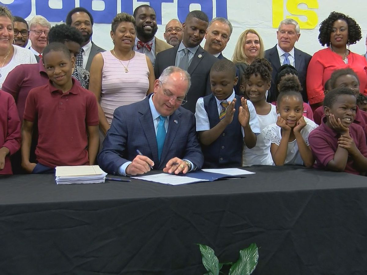 Gov. signs state budget with $200 million more for education