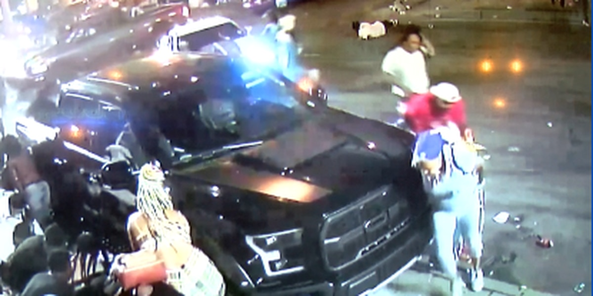 Surveillance video shows people scurrying from gunshots during a violent weekend