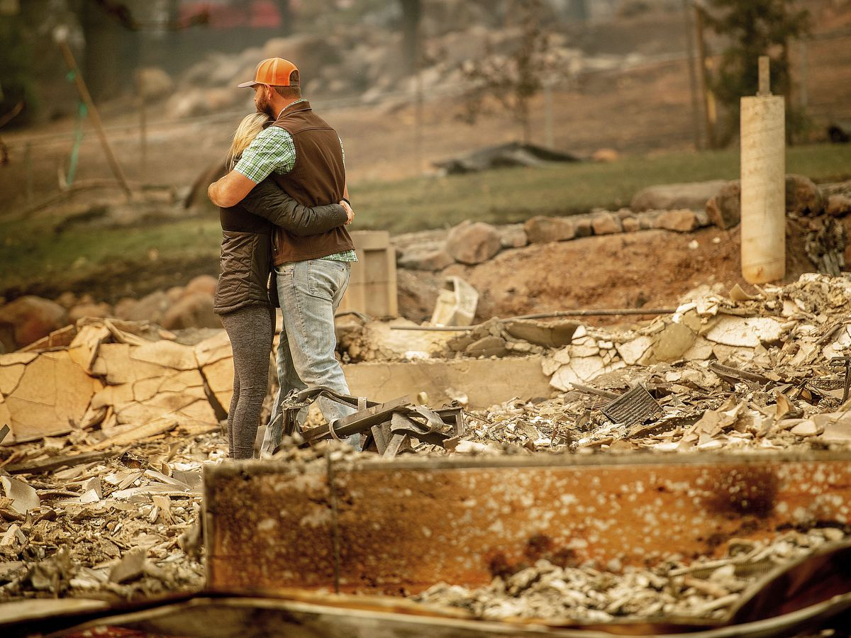 Holding out slim hope as crews search for more fire dead