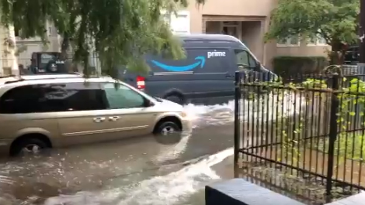 VIDEO: Drivers slosh through high water much to car owner's dismay