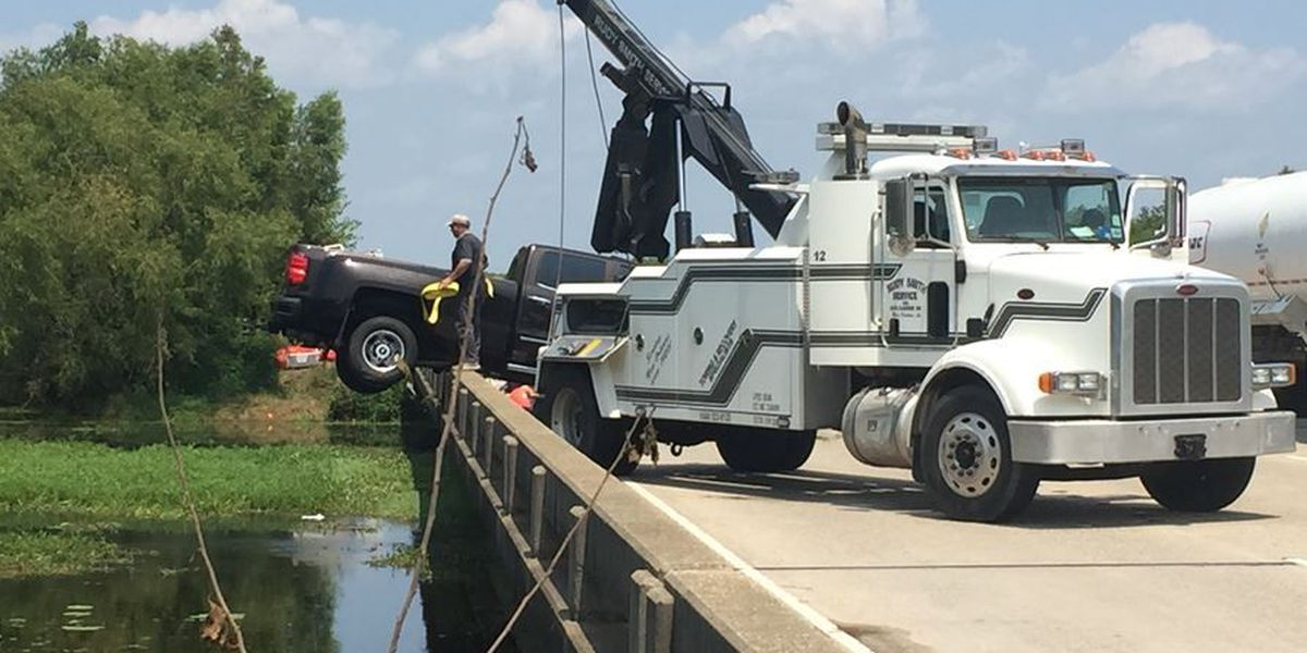 Body discovered after vehicle pulled from water on I-10