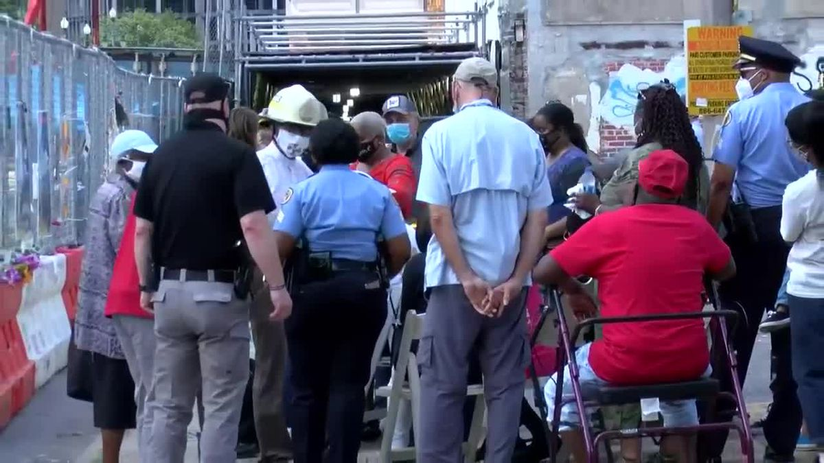 Family of Quinyonn Wimberly overcome with emotion as his remains are removed from Hard Rock collapse site