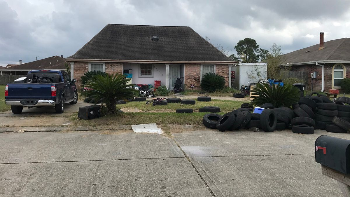 FOX 8 Defenders: Dozens of old tires found spilling onto residential street