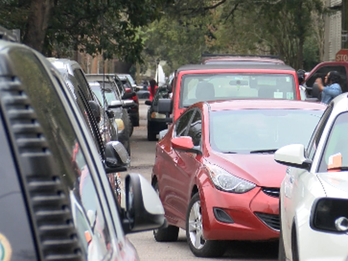 Parade goers park in the middle of streets on Fat Tuesday, causing gridlock