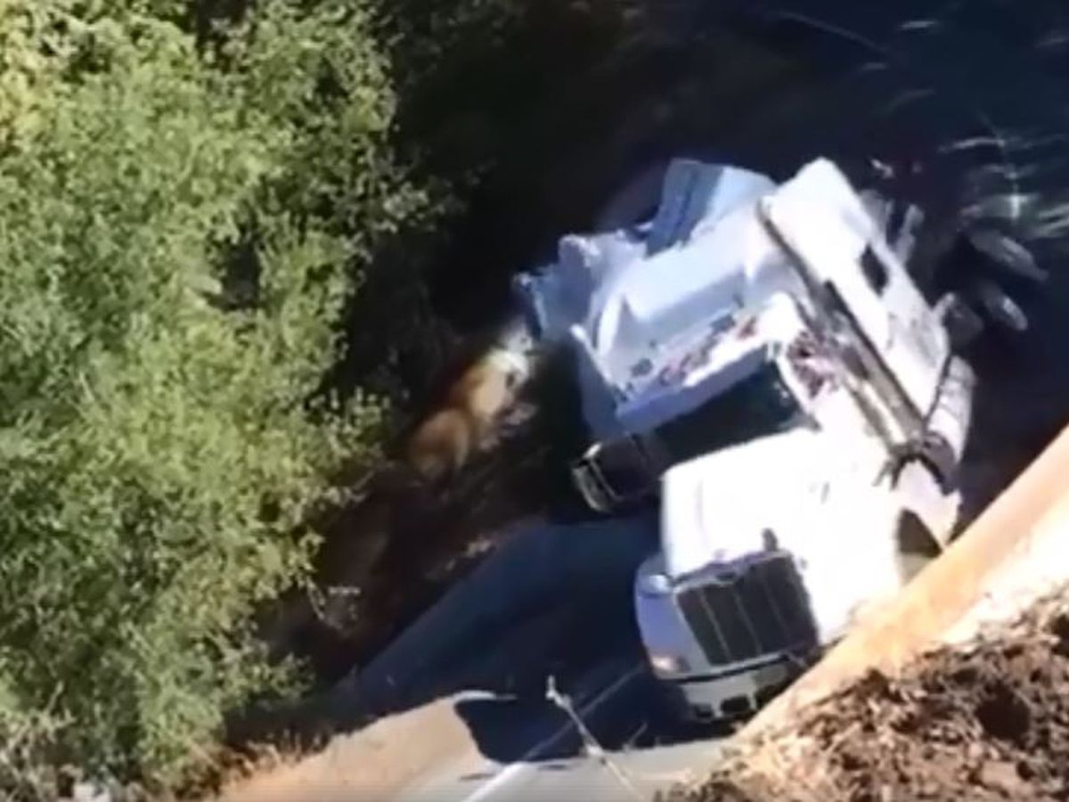 Video shows truck plummet after avoiding road signs