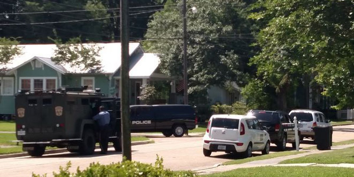 Man barricaded in home surrenders - WATCH FOX 8 now for the latest