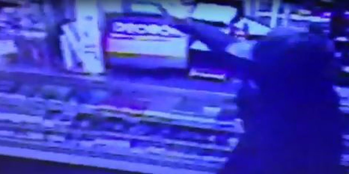 VIDEO: Armed man robs convenience store