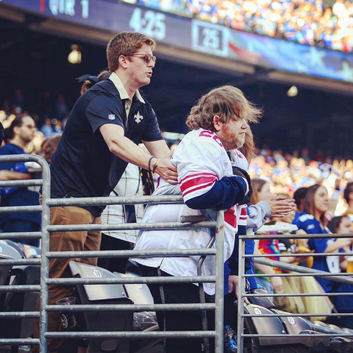 VIRAL PHOTO: Saints Fan Helps Disabled Giants Fan Stand