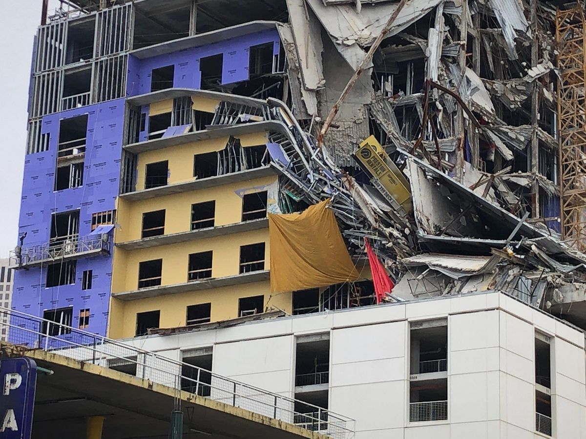 Crews replace tarp concealing worker's remains, find further collapse at Hard Rock site